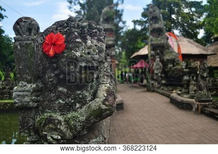 Art Sculpture And Carved Antique Deity Angel God Of Hindu Statue Balinese Style In Pura Taman Ayun O