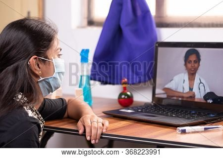 Concept Of Online Chat, Telehealth, Or Tele Counseling With Nurse Or Doctor On Screen During Coronav
