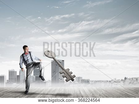Determined Businessman Against Modern Cityscape Breaking With Leg Stone Key Figure