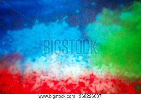 Colorful powder explosion on white background. Abstract pastel color powder particles
