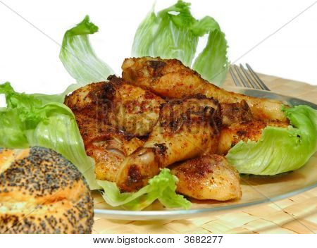 grilled chicken tootsies with roll and salad on egg white background poster