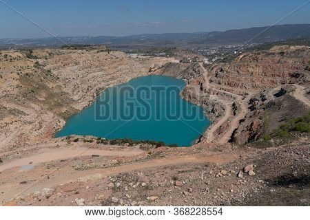 Top View Of An Open Pit In Balaclava, Azure Water Below In The Form Of A Heart. Without Photoshop, T