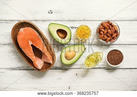 Food High In Omega-3 Fatty Acids On A White Wooden Background. Healthy Eating Concept. Salmon, Avoca