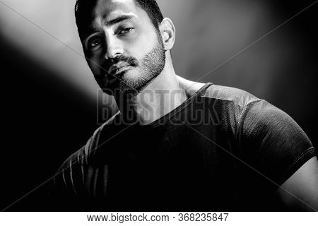 Bw Portrait Of Handsome Brutal Young Man With Confident Expression