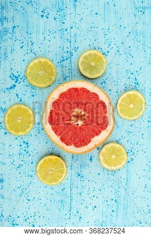 A Top View Grapefruits And Lemons Mellow Sour Ripe Sliced On The Bright Blue Backgorund