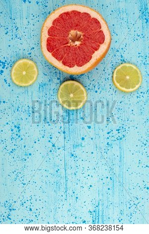 A Top View Lemons Grapefruits Sliced Mellow Ripe On The Bright Blue Background