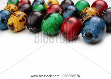 Frame Of Multi-colored Quail Eggs. Multi-colored Quail Easter Eggs On A White Background. Multi-colo
