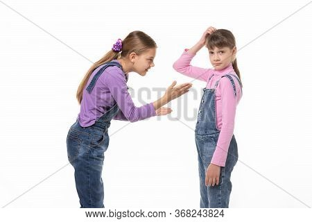 The Girl Is Trying To Explain Something To Her Sister, She Scratches Her Head In Perplexity
