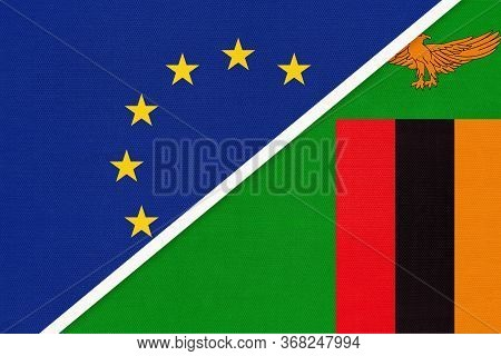 European Union Or Eu And Zambia National Flag From Textile. Symbol Of The Council Of Europe Associat