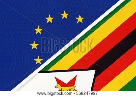 European Union Or Eu And Zimbabwe National Flag From Textile. Symbol Of The Council Of Europe Associ