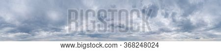 Large Panorama Of Cloudy Gray And White Sky With Thick Dense Clouds. Overcast Sky