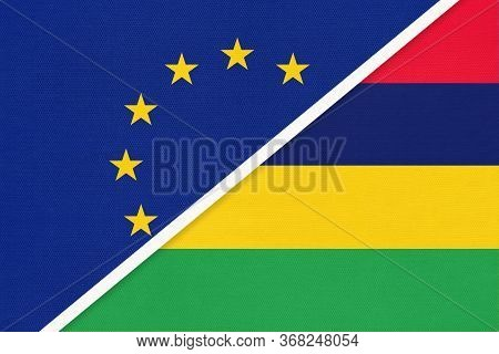 European Union Or Eu And Mauritius National Flag From Textile. Symbol Of The Council Of Europe Assoc