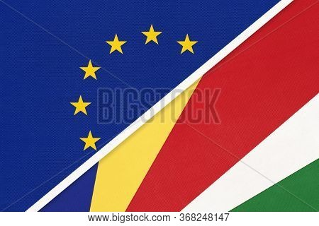 European Union Or Eu And Seychelles Islands National Flag From Textile. Symbol Of The Council Of Eur
