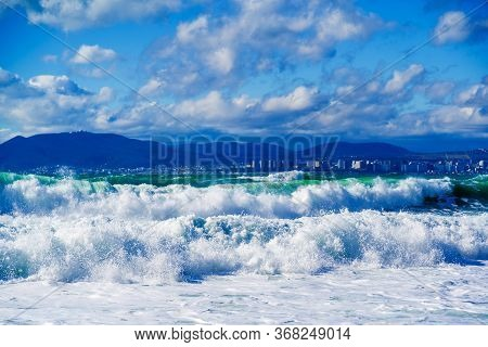 Beautiful Emerald Storm Waves In White Foam Against The Background Of Mount Myshako And The City Of
