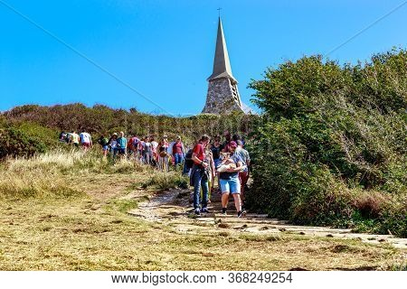 Etretat, France - September 1, 2019: Unidentified Tourists Descend From The D\'amont Cliff Along A S
