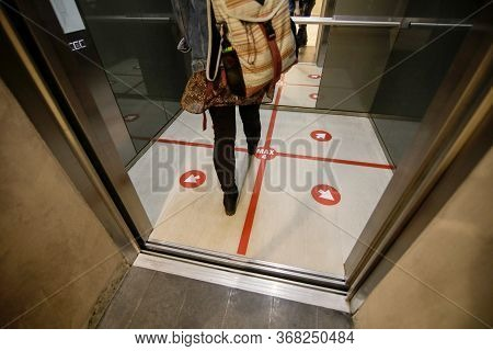 Details With An Elevator Floor Segmented In Four Places To Stand For Social Distancing During The Co