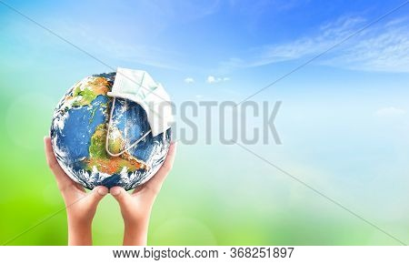 World Environment Day Concept: Corona Virus Or Covid-19 Earth Wearing A Mask , This Image Furnished