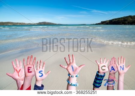 Children Hands Building Word Yes I Can, Ocean Background