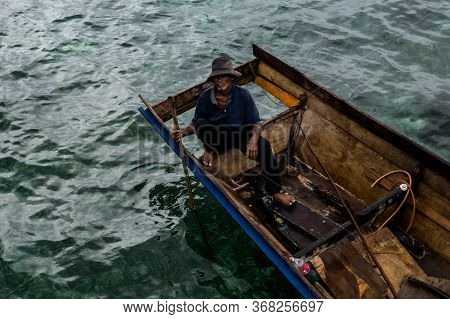 Mabul Island, Sabah, Malaysia - August 08, 2018: A Old Man With On The Small Boat, Floating On The B