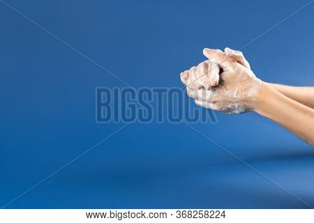 Wash Your Hand - Coronavirus Healthcare And Hygiene Concept. Photo Of Woman Hands With Soap Foam On