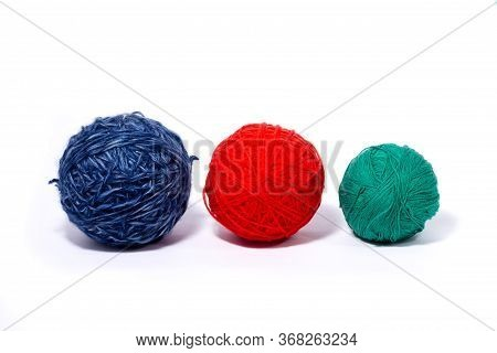 Three Woolen Skeins With Multi-colored Threads, Red, Blue, Green, Isolated On A White Background, Cl