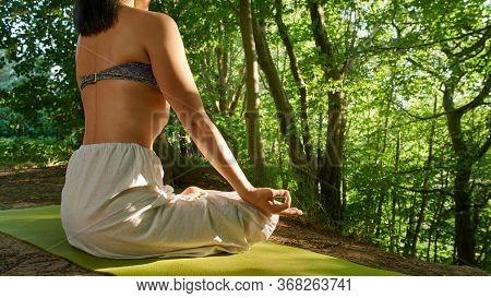 Yoga In Natural. Asian Woman Practicing Outdoors Yoga In Lotus Pose. Close Up Hands In Meditating Ge