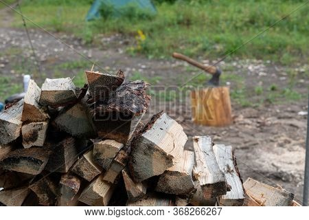 Logging. Chopping Wood With An Ax. Birch Firewood For Bonfire