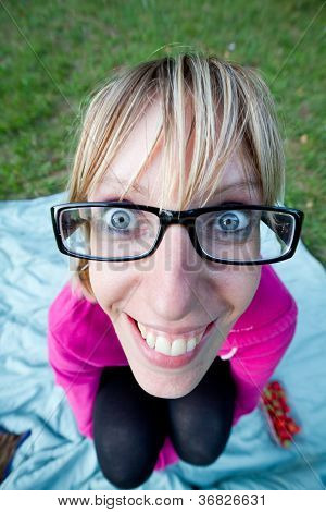 Wide Angle Shot Of Young Woman With Glasses