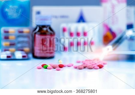 Selective Focus On Tablets And Capsule Pills On Blurred Drug Bottle, Stainless Steel Drug Tray, Blis