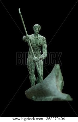 Ancient Iron Statue Of Charon Transports The Souls Of Dead People By Boat Across The Styx River. Anc