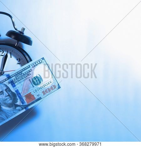 Time Is Money. Alarmclock With Us Dollar Money As Symbol Of Business, Wealth And Work.
