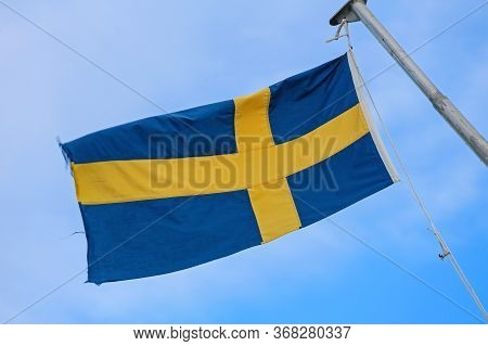 Swedish Flag Yellow Cross Over Blue At Sky