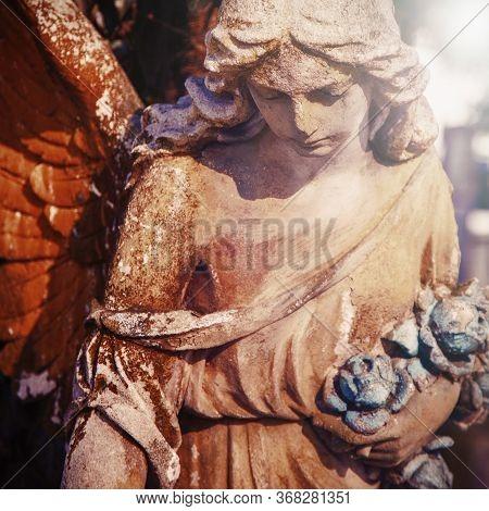 Sad Guardian Angel. Fragment Of An Beautiful Antique Statue.
