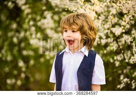 Full Of Joy. Happy Kid Has Lush Healthy Hair. Summer And Spring Fashion. Child Enjoy Blooming Nature