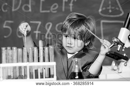 Boy Test Tubes Liquids Chemistry. Chemical Analysis. Kid Study Chemistry. Biotechnology And Pharmacy