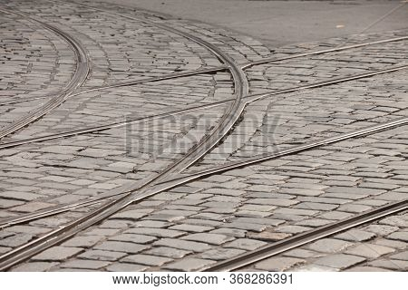 Close Up On A Tramway Rail Switch On A Cobblestone Pavement On An Old And Obsolete Street Where Publ