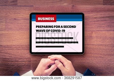 Preparing For A Second Wave Of Covid-19 In Business News. Businessman Read How To Prepare Company Fo