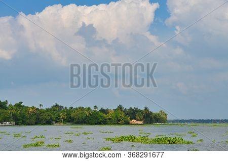 A Houseboat Docked In A Beautiful Kerala Backwaters Landscape
