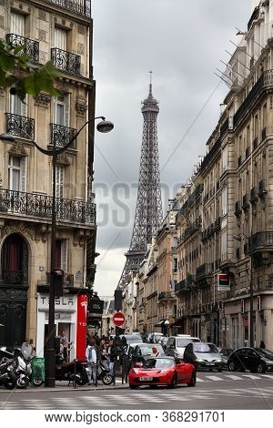 Paris, France - July 24, 2011: Cloudy Day Street View With Eiffel Tower In Paris, France. Paris Is T