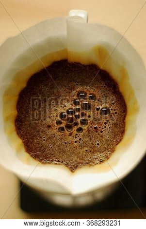 Freshly Brewed Coffee In A Funnel With Froth