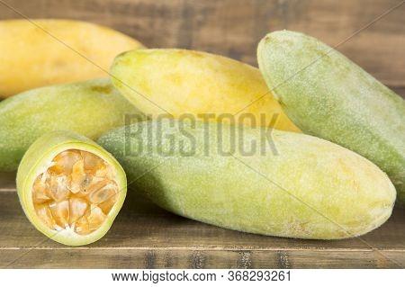 Curuba Tropical Fruit - Passiflora Tripartite. Wood Background