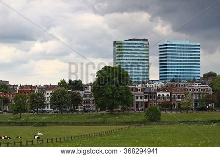Arnhem, Netherlands - May 13, 2020: The Two Modern Wtc Towers Behind The Ancient Houses And The Mead