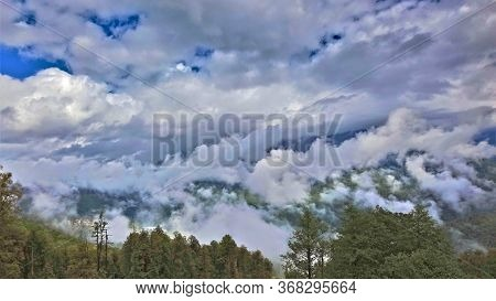 Amazing Clouds In The Caucasus Mountains. Fall. Fluffy Clouds, Like Shreds Of Cotton Wool, Lie On Tr