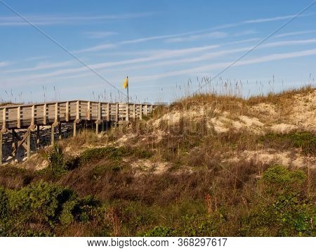 Anastasia State Park In St. Augustine, Florida At Golden Hour, With A Wooden Boardwalk And Sand Dune