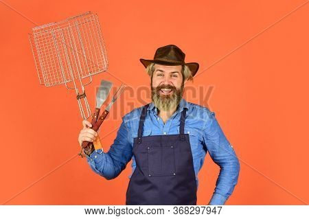Picnic And Barbecue. Bearded Farmer Wear Hat And Apron For Barbecue. Roasting Meat. Steak And Barbec