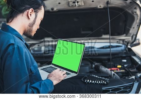 Mechanic Engineer Is Diagnosing Car Engine And Electric Adjusting Transmission With Computer Laptop,