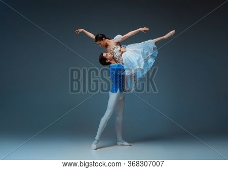 Young And Graceful Ballet Dancers As Cindrella Fairytail Characters On Studio Background. Art, Motio