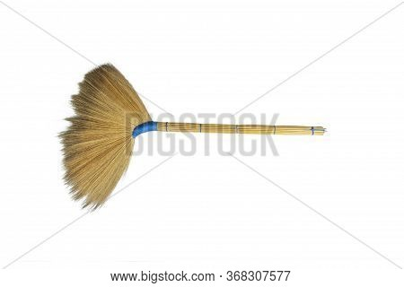 Old Traditional Hand Made Broom,from Flowers And Grass Are Hand-made On White Background​.blue Braid