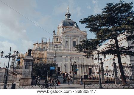 Madrid, Spain - January 26, 2020: People Outsdie Amudena Cathedral (catedral De La Almudena), A Cath