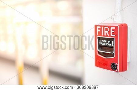 The Red Fire Alarm Switch On The White Wall At The Supermarket, For The Safety First When The Fire B